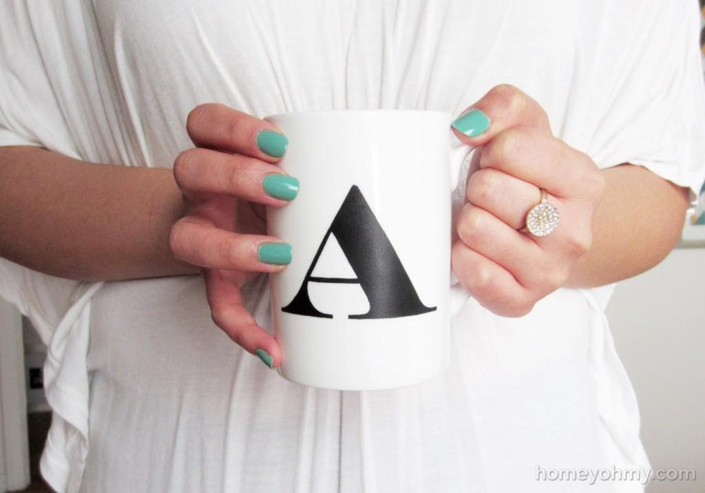 Monogrammed cup held