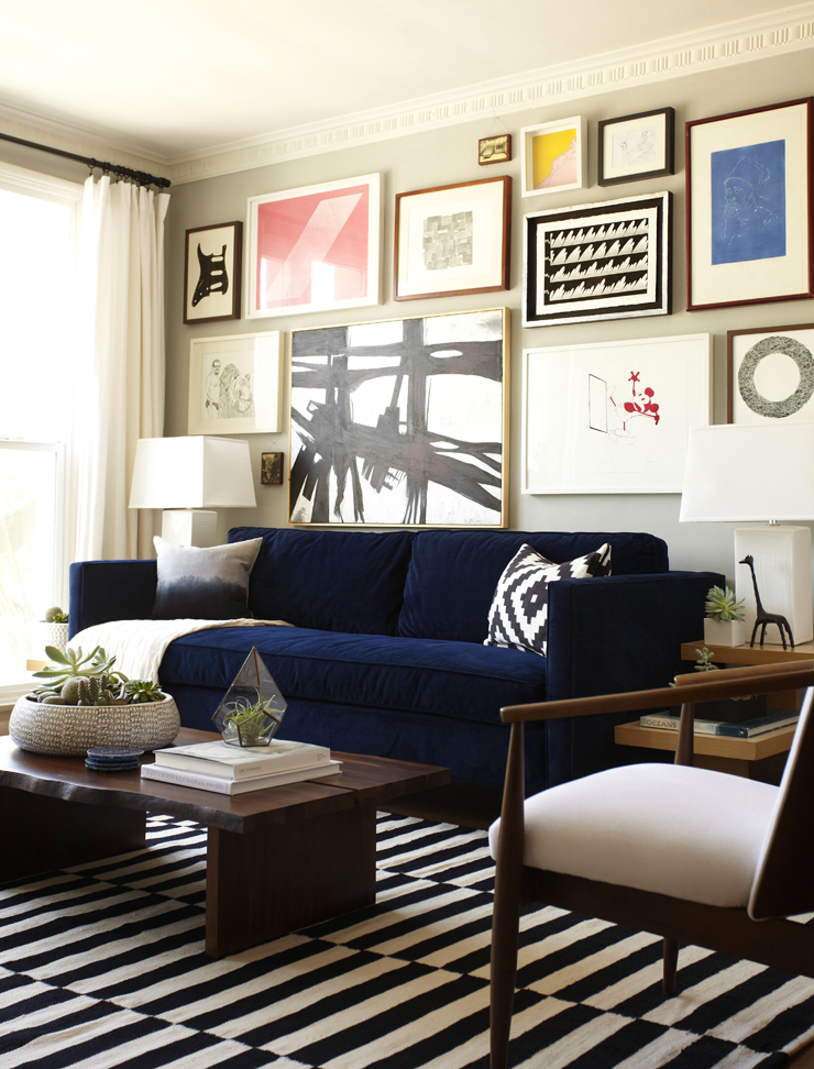 Blue velvet couch and gallery wall
