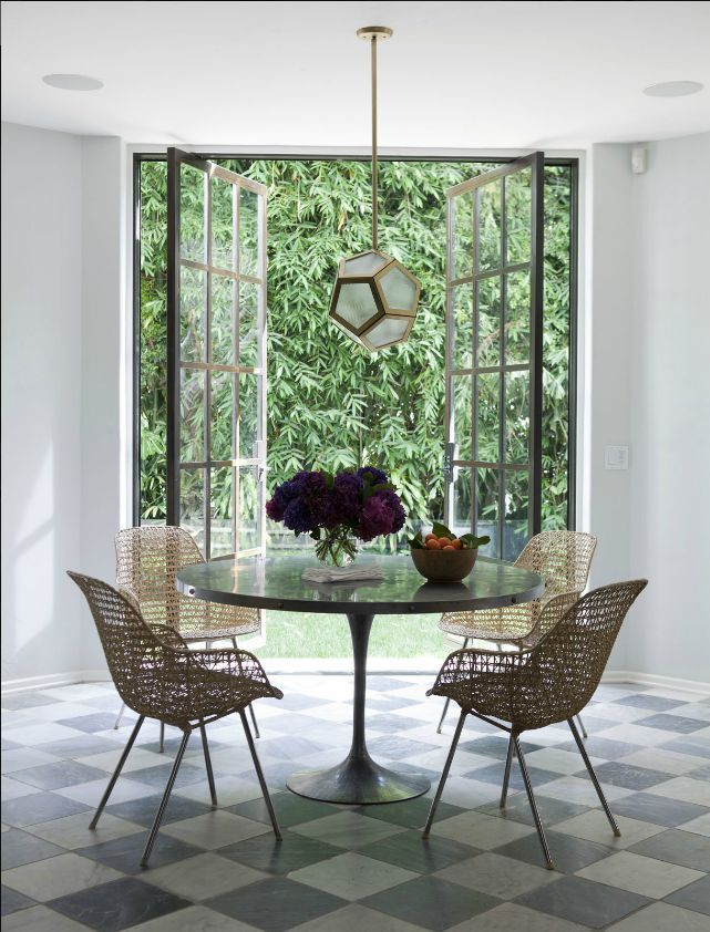 Dining area with tulip table, design by Nate Berkus