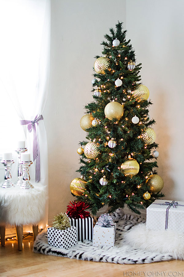 Christmas tree with large gold ornaments - Homey Oh My