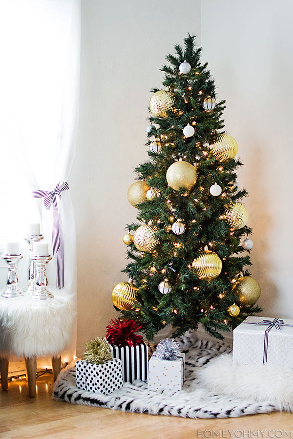skinny christmas tree with large gold ornaments great for big impact in a small space - Large Christmas Tree Ornaments