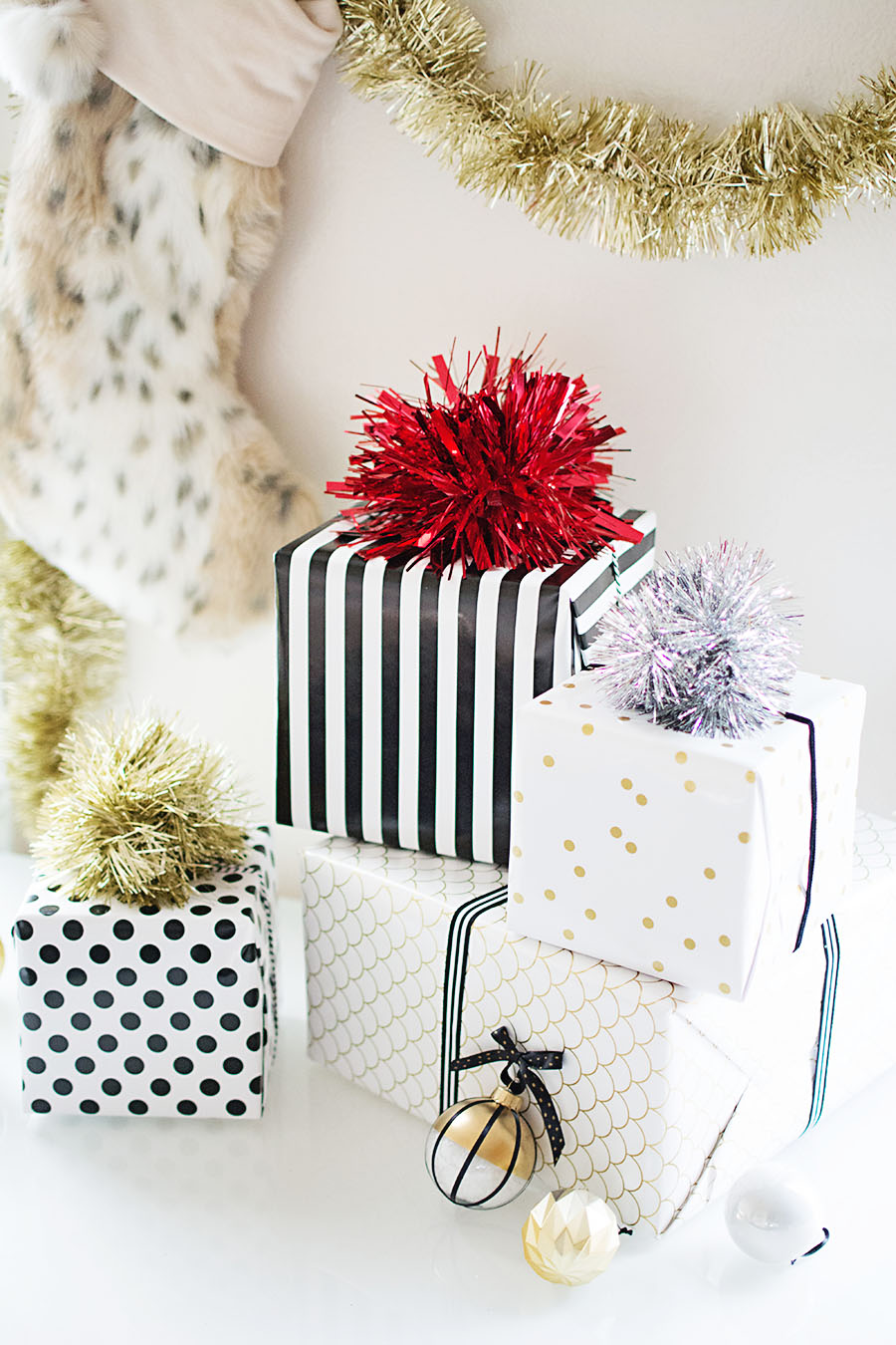 diy tinsel pom pom gift topper homey oh my. Black Bedroom Furniture Sets. Home Design Ideas