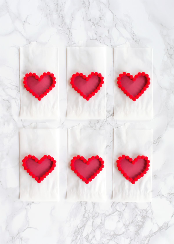 DIY Valentines Day Pom Pom Heart Treat Bags