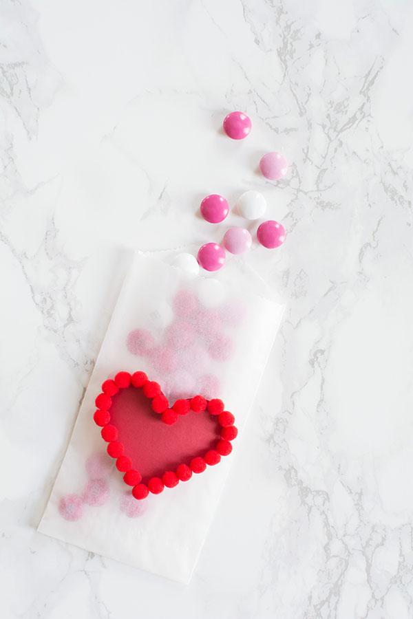 DIY pom pom heart treat bag