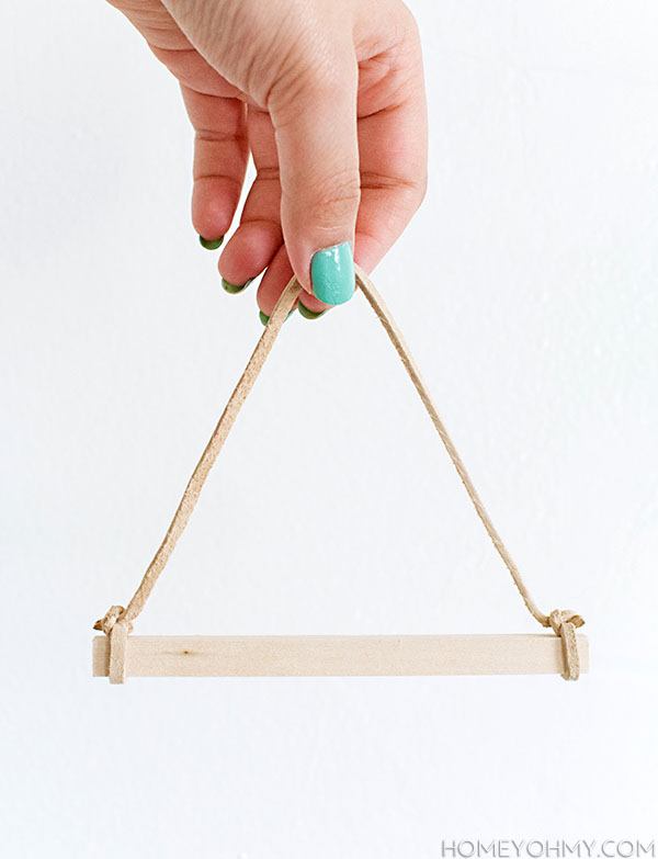 Wood and suede hanger