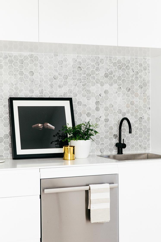 black faucet hex tile