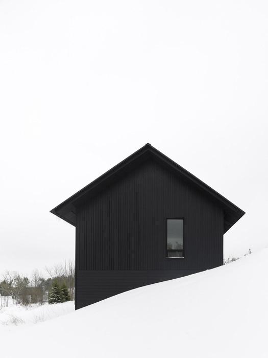 black-winter-cabin