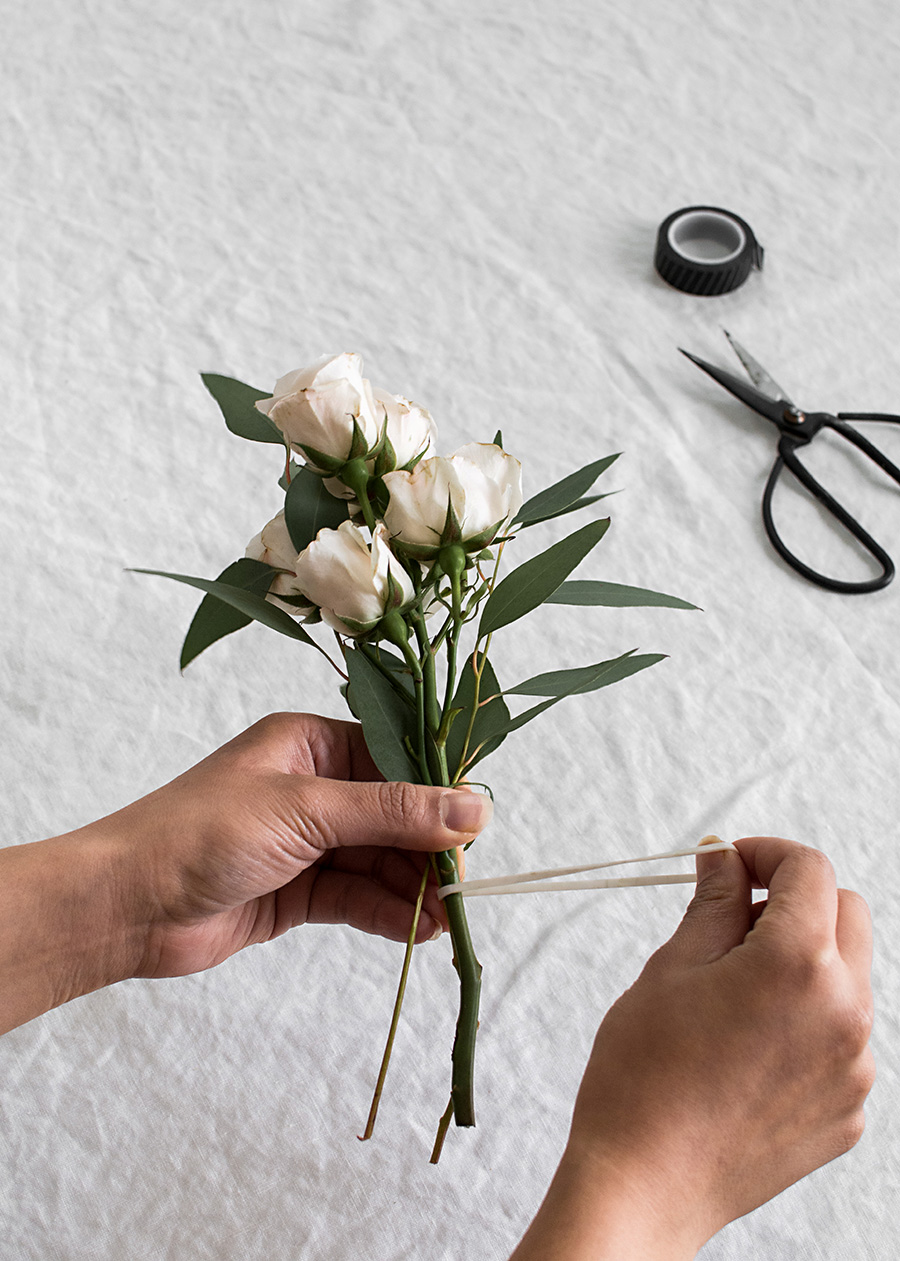 Diy mini bouquets homey oh my bunch your flowers together cut down the stems to desired length and place a rubber band around one of the stems like so a note on picking flowers i izmirmasajfo