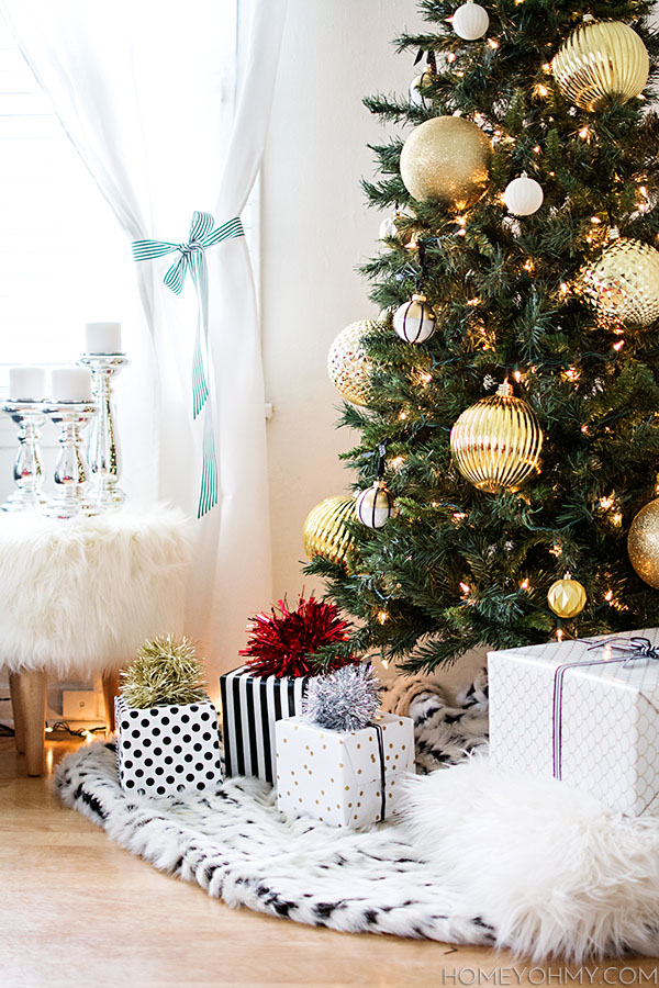 Christmas tree gold ornaments.  Use a fur throw as a simple tree skirt!