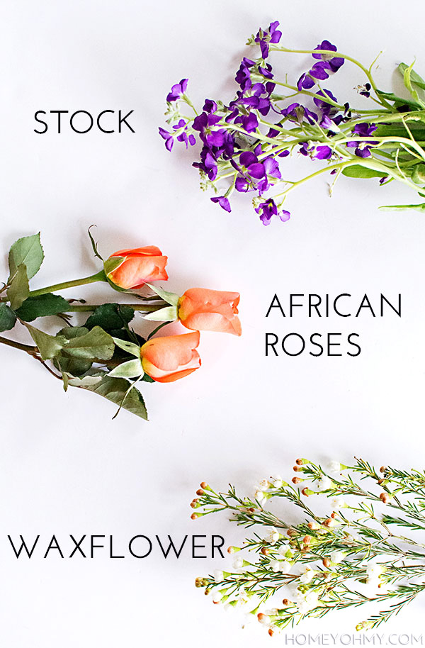 Stock, African roses, and waxflower