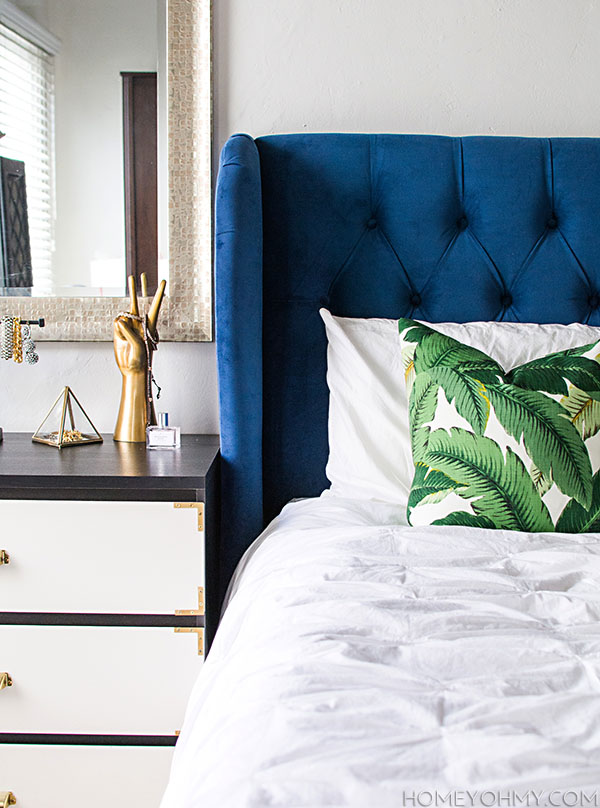 Blue headboard and banana leaf pillow