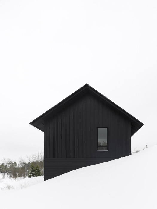 black-winter-cabin